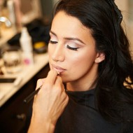 Bride having her makeup done by makeup artist Lisa Capuchino